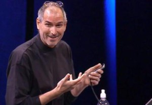 article_teaser_steve_jobs_holds_iphone_and_smiles_during_iphone_macworld_2007_introduction